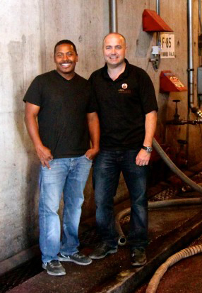 Winemaker Joseph Smith and Partner Tyson Rippey in front of the 70+ year old Concrete tank.